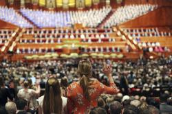 People participate in a solemn assembly during the start of a twice-annual conference of The Church of Jesus Christ of Latter-day Saints, in Salt Lake City.