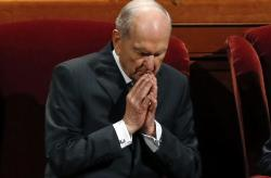 The Church of Jesus Christ of Latter-day Saints President Russell M. Nelson prays during the church's twice-annual conference, in Salt Lake City.