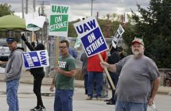 John Kirk, right, a 20-year-employee, pickets with co-workers outside the General Motors Fabrication Division, Friday, Oct. 4, 2019, in Parma, Ohio