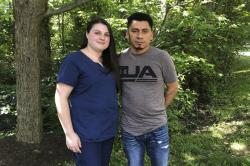 In a photo taken June 21, 2019, Alyse Sanchez and her husband, Elmer Sanchez, pose for The Associated Press in Sandy Spring, Md.