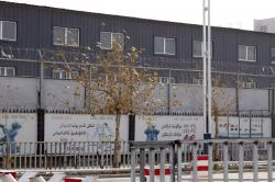"In this Dec. 5, 2018, file photo, two layers of barbed wire fencing ring the ""Hotan City apparel employment training base"" where Hetian Taida Apparel Co. has a factory in Hotan in western China's Xinjiang region"