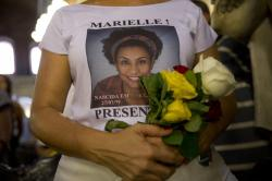 A woman wears a T-shirt designed with an image of slain councilwoman Marielle Franco during a memorial Mass to mark the one-year anniversary of her death, at the Candelaria Catholic Church in Rio de Janeiro, Brazil.