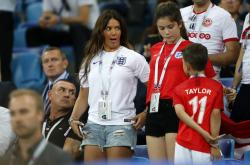 Rebekah Vardy, wife of England's forward Jamie Vardy, reacts their match against Tunisia at the 2018 soccer World Cup in the Volgograd Arena in Volgograd, Russia.