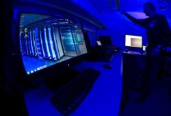 This Friday Jan. 11, 2013 file photo of a member of the Cybercrime Center as he turns on the light in a lab during a media tour at the occasion of the official opening of the Cybercrime Center at Europol headquarters in The Hague, Netherlands