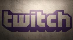 This Saturday, Nov. 4, 2017, file photo shows the logo of live streaming video platform Twitch at the Paris games week in Paris