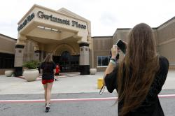 Brinley Rawson, a 17-year-old Stranger Things fan from Gwinnett County, snaps a photo of Gwinnett Place Mall in Duluth, Ga.