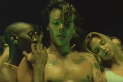 "Harry Styles in his music video ""Lights Up."""