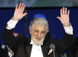 In this Aug. 28, 2019, file photo, Opera star Placido Domingo performs during a concert in Szeged, Hungary.