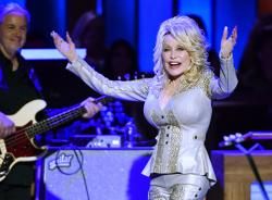 In this Saturday, Oct. 12, 2019, photo Dolly Parton performs at her 50th Opry Member Anniversary at the Grand Ole Opry in Nashville, Tenn.