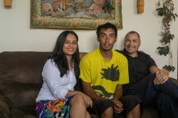 Matt Vinnola (center) sits with his mother, Janet van der Laak, and stepfather, Onne van der Laak.