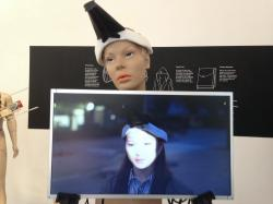 """This 2017 photo provided by artist Jing-cai Liu shows her work titled """"Wearable Face Projector"""" at a gallery in Utrecht, Netherlands"""
