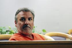 Brian Steven Smith looks out in the courtroom while waiting for his arraignment to start Wednesday, Oct. 16, 2019, in Anchorage, Alaska.