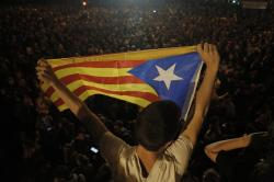 """A man holds an """"estelada"""" or independence flag during a protest in Barcelona, Spain, Thursday, Oct. 17, 2019."""