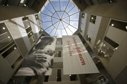 In this July 30, 2013, file photo, large banners hang in an atrium at the headquarters of Johnson & Johnson in New Brunswick, N.J.