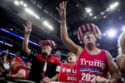 "Members of the audience wear ""Trump 2020"" cowboy hats and chant, ""Four More Years,"" as President Donald Trump speaks at a campaign rally at American Airlines Arena in Dallas, Texas, Thursday, Oct. 17, 2019."