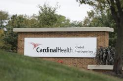 In this Wednesday, Oct. 16, 2019, file photo, a sign is displayed at the Cardinal Health, Inc. corporate office in Dublin, Ohio