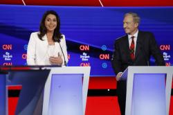 Democratic presidential candidate Rep. Tulsi Gabbard, D-Hawaii, left, and businessman Tom Steyer participate in a Democratic presidential primary debate hosted by CNN and The New York Times at Otterbein University, Tuesday, Oct. 15, 2019, in Westerville, Ohio