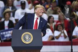 In this Oct. 17, 2019, photo, President Donald Trump speaks during a campaign rally at the American Airlines Center in Dallas