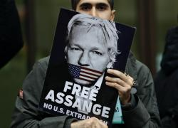 Supporters of Wikileaks founder Julian Assange demonstrate outside Westminster Magistrates' Court in London where Assange is expected to appear as he fights extradition to the United States on charges of conspiring to hack into a Pentagon computer, in London, Monday Oct. 21, 2019