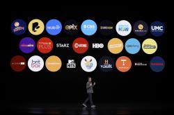 Peter Stern, Apple Vice President of Services, speaks at the Steve Jobs Theater during an event to announce new products in Cupertino, Calif.