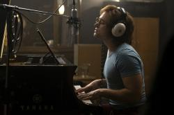 "Taron Egerton as Elton John in a scene from ""Rocketman."""
