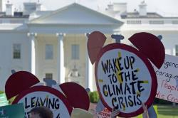 In this June 1, 2017 file photo, protesters gather outside the White House in Washington to protest President Donald Trump's decision to withdraw the Unites States from the Paris climate change accord