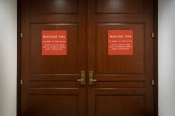 n this Nov. 6, 2019, photo, bright red signs alert non-authorized personnel at the entrance to the House SCIF, the Sensitive Compartmented Information Facility, located three levels beneath the Capitol where witnesses and lawmakers hold closed interviews in the impeachment inquiry on President Donald Trump's efforts to press Ukraine to investigate his political rivals, in Washington