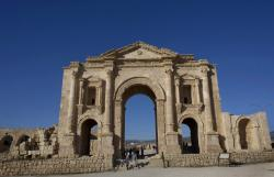 Tourists pass through the Arch of Hadrian, built during the Roman Empire, and the South Gate of the well preserved Ancient Roman city of Gerasa.