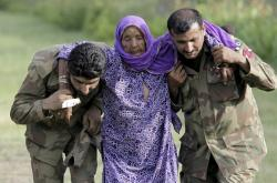 In this July 30, 2010, file photo, Pakistani army soldiers help an elderly villager evacuated from a flooded area in Nowshera, Pakistan