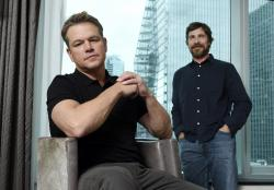 "Matt Damon, left, and Christian Bale posing for a portrait to promote their film ""Ford v Ferrari."""