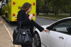 News Corp. journalist Annika Smethurst gets on a car while leaving the High Court of Australia in Canberra, Australia, Tuesday, Nov. 12, 2019