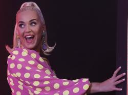 Singer Katy Perry gestures as she leaves after addressing press conference ahead of her performance in Mumbai, India.