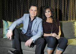Donny Osmond, left, and Marie Osmond pose backstage at their show at the Flamingo hotel and casino in Las Vegas.