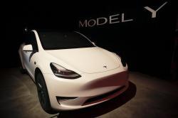 In this March 14, 2019, file photo Tesla's Model Y is displayed at Tesla's design studio in Hawthorne, Calif.