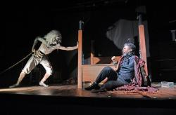 "Taavon Gamble as Jacob Marley (left) and Jude Sandy as Ebenezer Scrooge in ""A Christmas Carol"" at the Trinity Repertory Company. (Photo by Mark Turek)"
