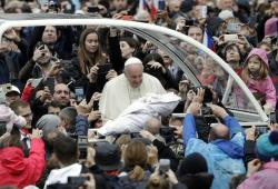 Pope Francis is given a newborn baby to bless as he arrives for his weekly general audience in St. Peter's Square, at the Vatican, Wednesday, Nov. 13, 2019
