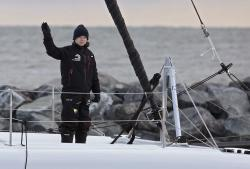 Swedish teen climate activist Greta Thunberg waves from the 48-foot (15-meter) catamaran La Vagabonde as it departs Salt Ponds in Hampton, Va., on Wednesday, Nov. 13, 2019