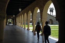 In this March 14, 2019, file photo people walk on the Stanford University campus in Santa Clara, Calif.