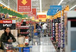 In this Nov. 9, 2018, file photo shoppers look at televisions at a Walmart Supercenter in Houston