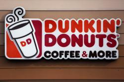 This Jan. 22, 2018 file photo shows the Dunkin' Donuts logo on a shop in Mount Lebanon, Pa.