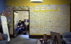 """In this Oct. 1, 2019, photo, the """"What Brings You Joy?"""" wall is covered with people's writings at the office of the nonprofit Advocacy Unlimited in New Britain, Conn."""