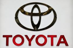 This photo taken Feb. 14, 2013, shows the Toyota logo on a sign at the Pittsburgh Auto Show in Pittsburgh
