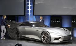 Karma Automotive Andreas Thurner, Vice President for Global Design and Architecture, left, and Todd George, VP of Platform Engineering at Karma Automotive, unveil Karman Vision SC2 concept vehicle at Automobility LA Auto Show in Los Angeles Tuesday, Nov. 19, 2019