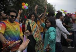 Members of the LGBTQ community and their supporters march during the annual Delhi Queer Pride parade in New Delhi, India.
