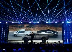 In this Nov. 21, 2019, file photo, Tesla CEO Elon Musk introduces the Cybertruck at Tesla's design studio in Hawthorne, Calif.