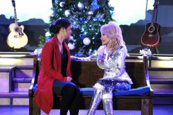 "Danica McKellar, left, and Dolly Parton in a scene from ""Christmas at Dollywood."""