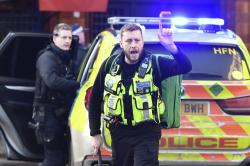 Police and emergency services at the scene of an incident on London Bridge in central London following a police incident, Friday, Nov. 29, 2019.
