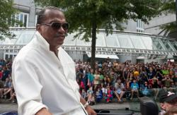 Actor Billy Dee Williams rides atop a car in a parade during the annual Dragon Con sci-fi and fantasy convention in Atlanta.