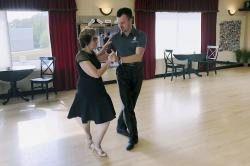 In this Oct. 7, 2019, photo, dance instructor Ned Pavlovic, a native of Serbia, teaches his student Rouhy Yazdani, a native of Iran who now lives in Milford, Conn., some ballroom dance moves at the Fred Astaire Dance studio in Orange, Conn.