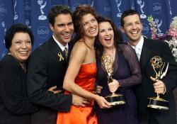 "Shelley Morrison, from left, Eric McCormack, Debra Messing, Megan Mullally and Sean Hayes celebrate their awards for their work in ""Will & Grace"" at the 52nd annual Primetime Emmy Awards in Los Angeles."